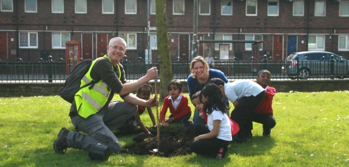Children planting elm