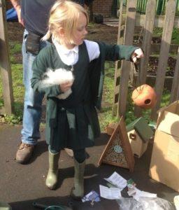 Children filling nesting material apple