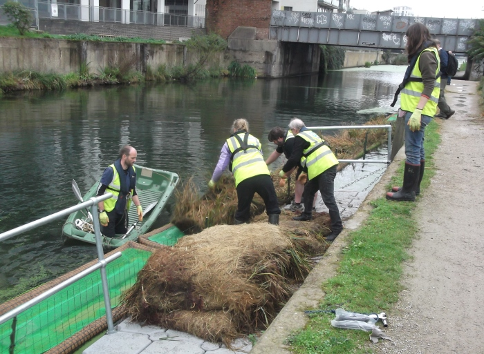 Installing floating raft in canal