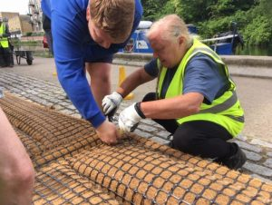Fitting coir mats to raft base