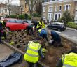 Volunteers planting flowers on the Malmesbury Estate