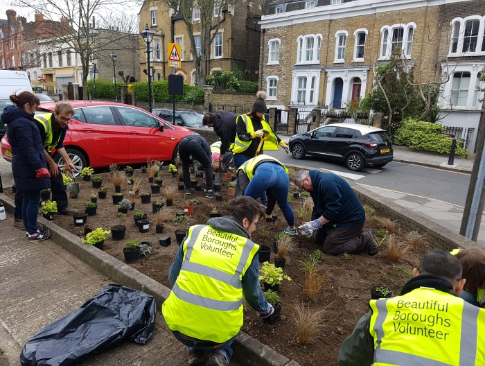 Volunteers planting flowers on the Malmesbury Estate