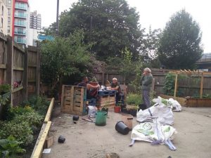 Residenct working in community garden