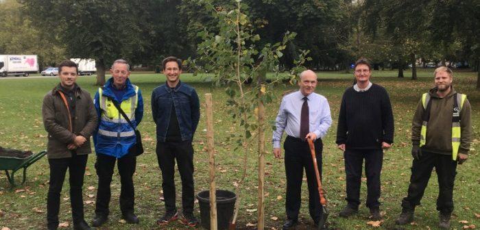 Mayor and volunteers planting tree