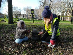 Phtoto of volunteers planting bulbs