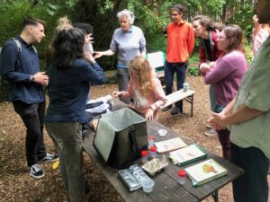 Photo of people at a community moth trapping event